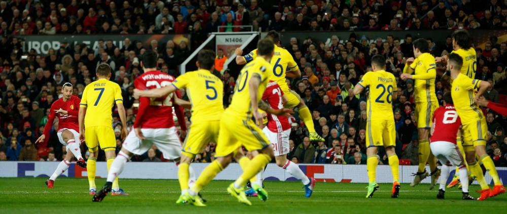 Manchester United's Zlatan Ibrahimovic poor attempt doesn't breach the Rostov wall.