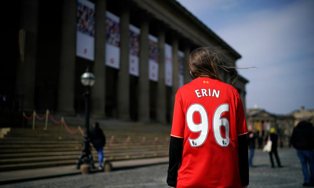 A supporter outside St George's Hall.