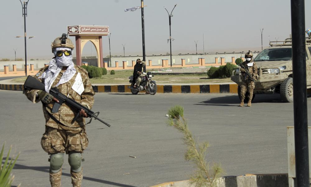 Taliban commando fighters stand guard in Lashkar Gah, Helmand province.