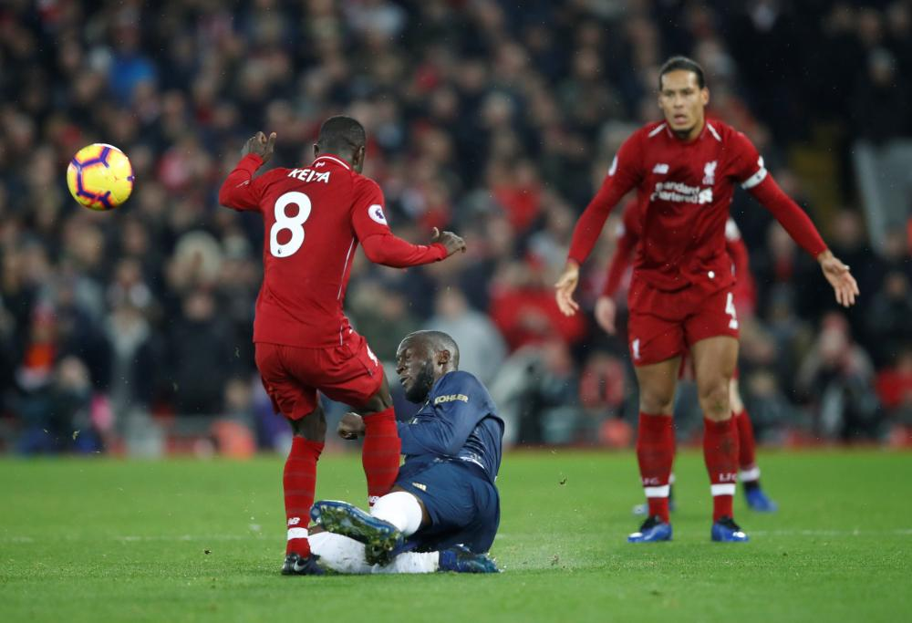 Liverpool's Naby Keita is fouled by Manchester United's Romelu Lukaku