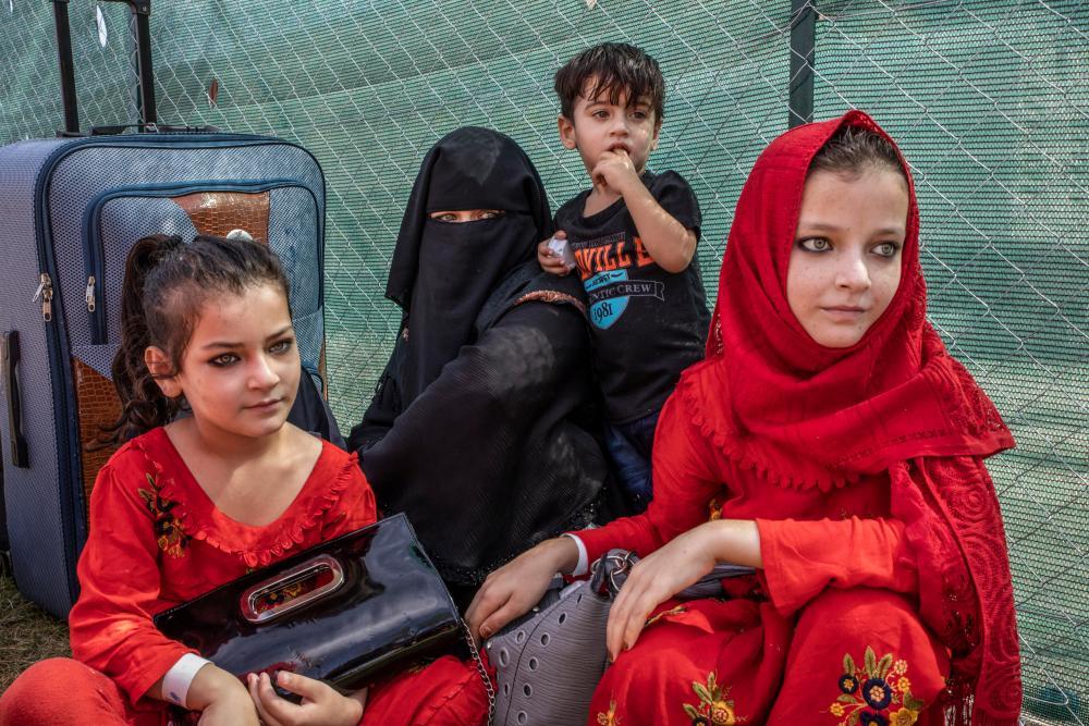 Afghan refugees at US base in Sicily.