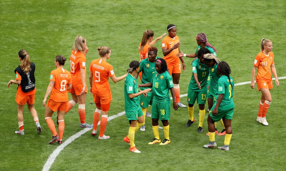 The players shake hands at the final whistle.