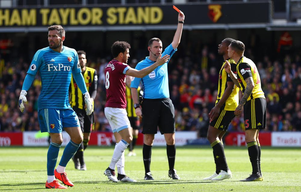 Holebas is sent off, after his challenge on Antonio.