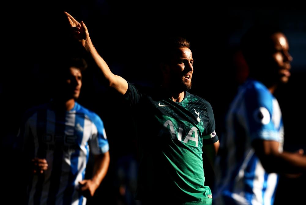 September 29: Harry Kane of Tottenham Hotspur signals for the ball against Huddersfield Town.