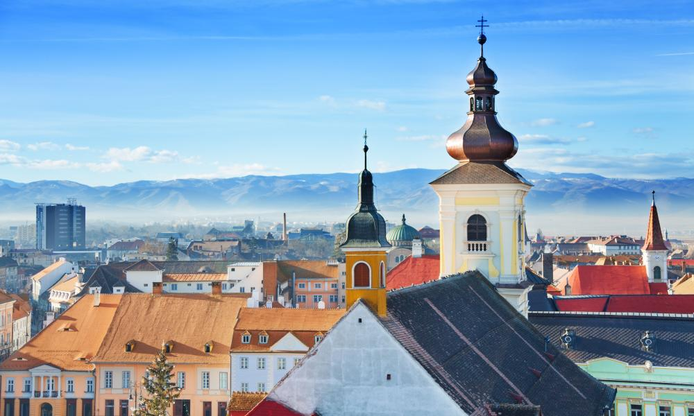 Roman Catholic Church and old town in Sibiu, Romania.