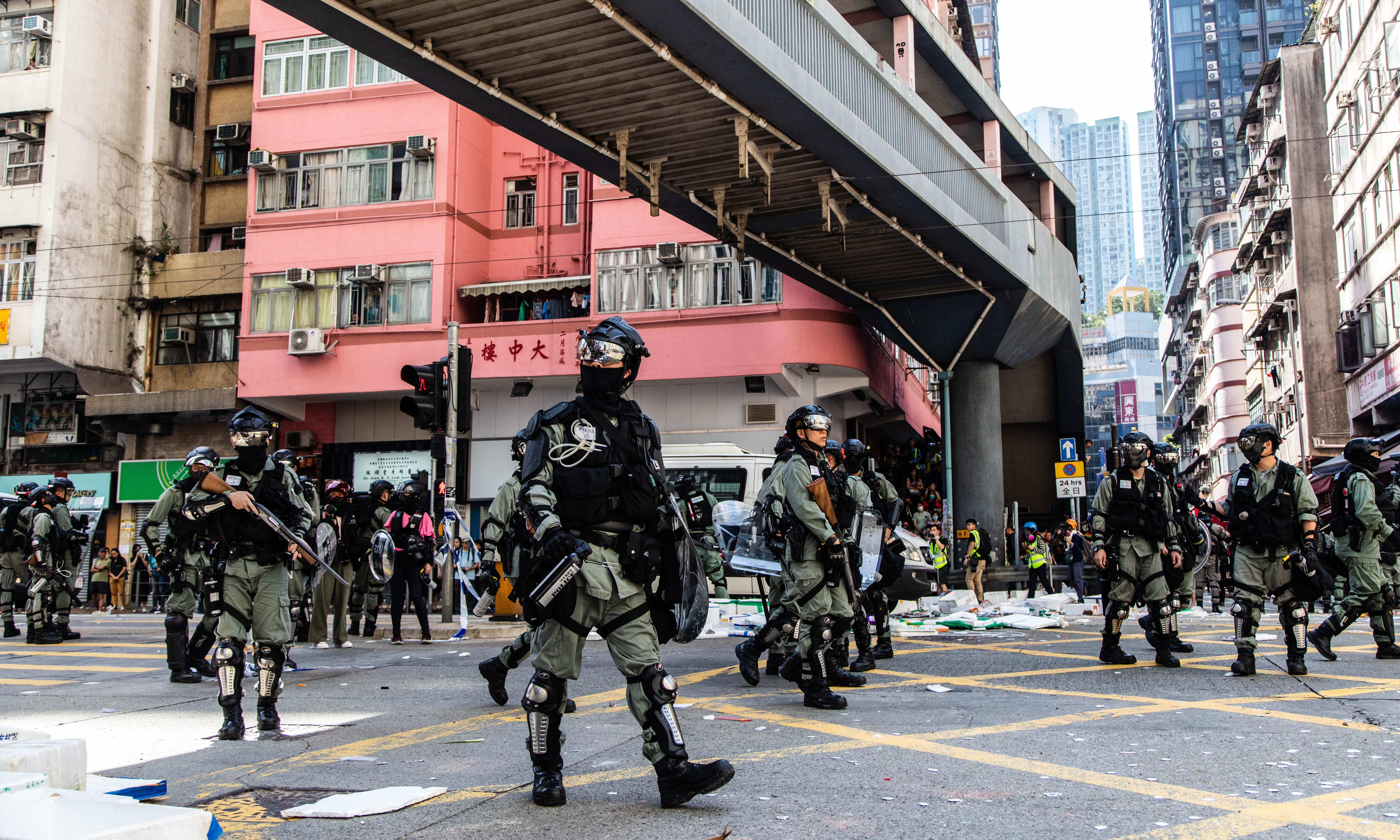 Protesters are pushing Hong Kong to brink of collapse, say police