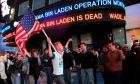 People react to the death of Osama bin Laden in Times Square in New York early May 2, 2011.