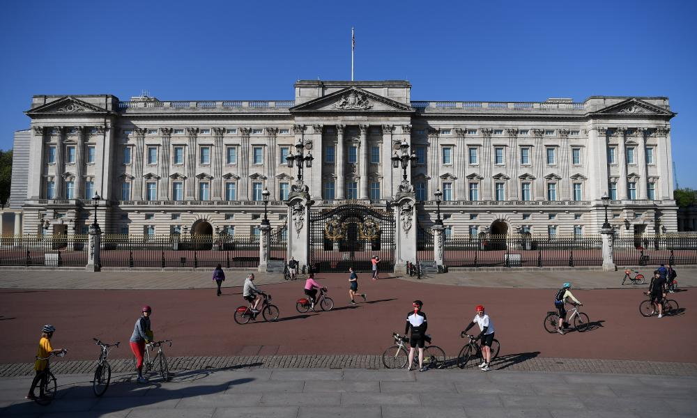 Socially-distanced cyclists enjoy the warmer weather outside Buckingham Palace on Sunday, as the UK lockdown continues.