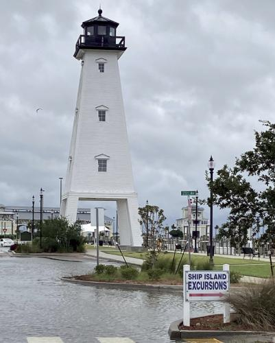 The parking lot adjacent to the Jones Park Lighthouse in Gulfport, Miss., floods from the waters from the Gulf of Mexico cresting before Hurricane Sally reaches land.