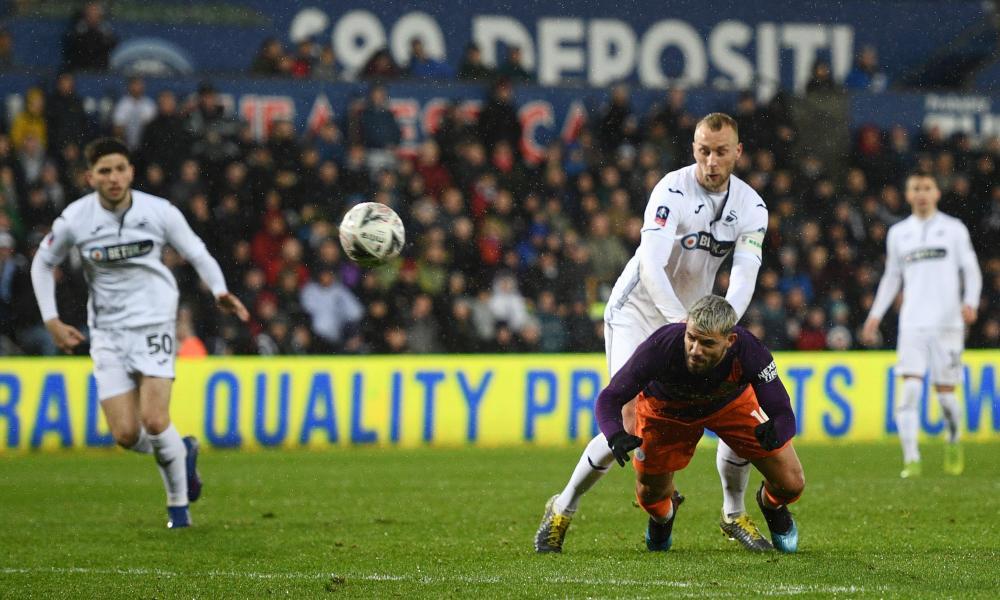 Sergio Aguero of Manchester City scores his team's third goal.
