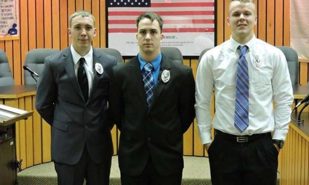 As part of the settlement, Stephen Mader, center, was also granted a pledge that his former employer would not prevent him from obtaining a new job in law enforcement elsewhere.
