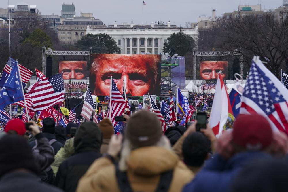 Trump supporters participate at the rally in Washington today.