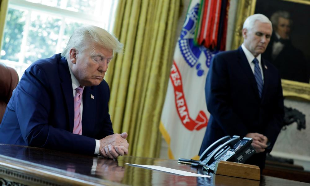 Trump and Pence, at prayer in the Oval Office.