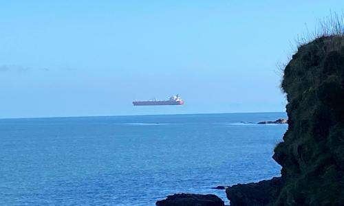 Walker 'stunned' to see ship hovering high above sea off Cornwall