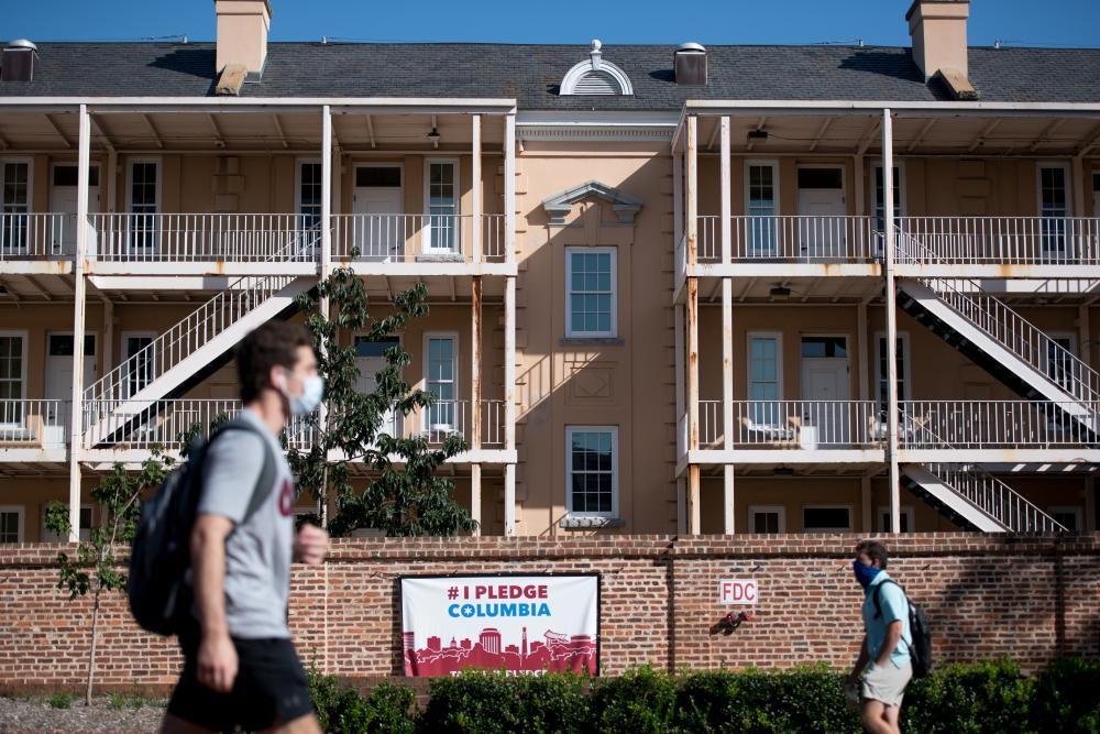 Students walk on campus at the University of South Carolina on 3 September 2020 in Columbia, South Carolina. During the final week of August the university reported a 26.6% positivity rate among the student population tested for Covid-19.