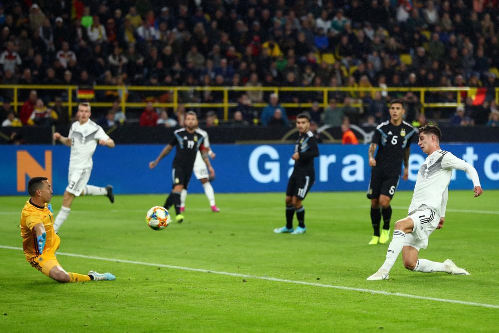 Kai Havertz of Germany scores his team's second goal.
