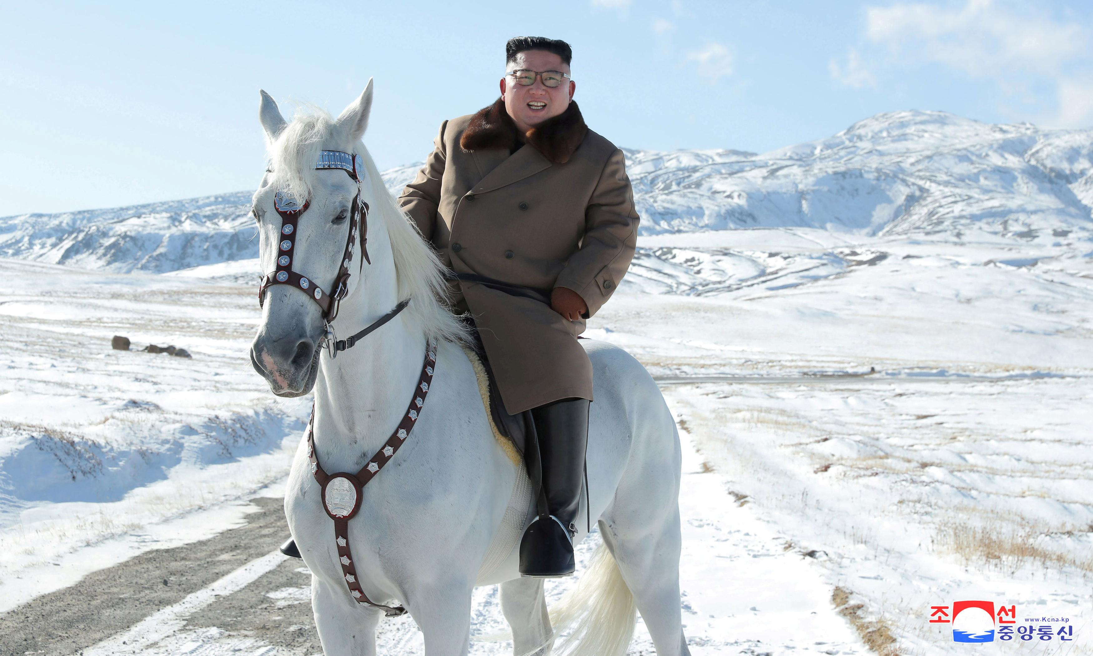 Kim Jong-un jockeys for attention with horse ride up sacred mountain