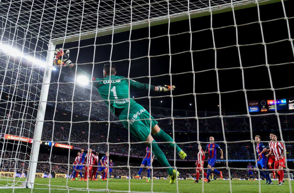 Neymar squeezes the ball between the upright and Iva Cuellar's hand for Barça's fifth goal.