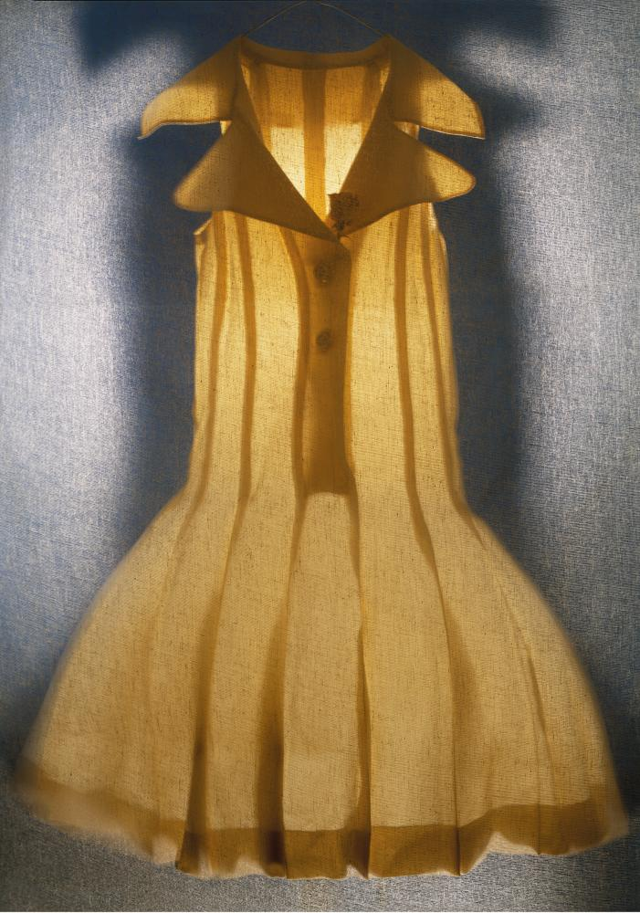 A yellow dress lit from behind