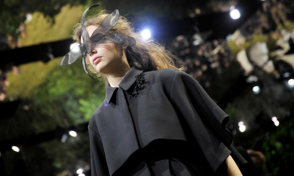Black net dragonfly masks struck a sharply surreal note
