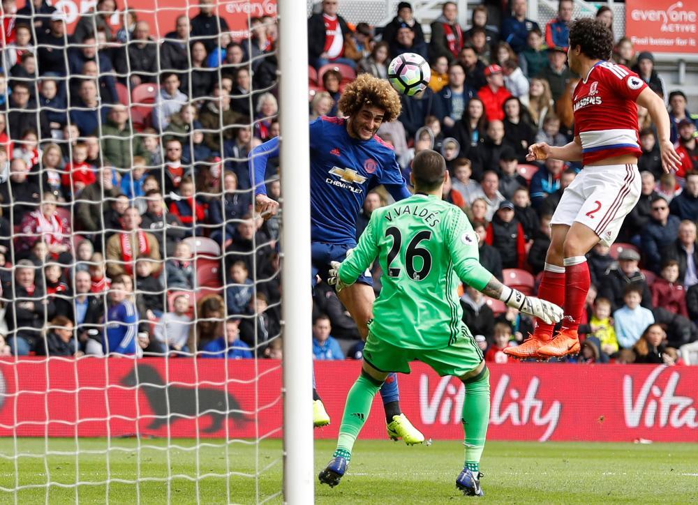 United's Marouane Fellaini scores the first goal