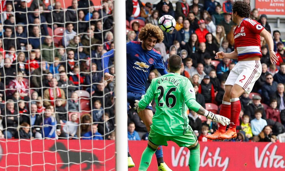 Marouane Fellaini heads Manchester United into the lead.