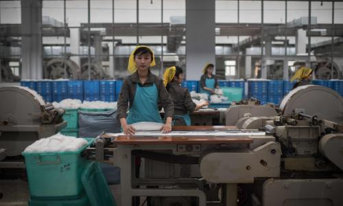 Staff working at the Kim Jong-suk silk mill in Pyongyang. Foreign press are regularly taken around the factory, named after North Korea's founder Kim Il-sung's first wife