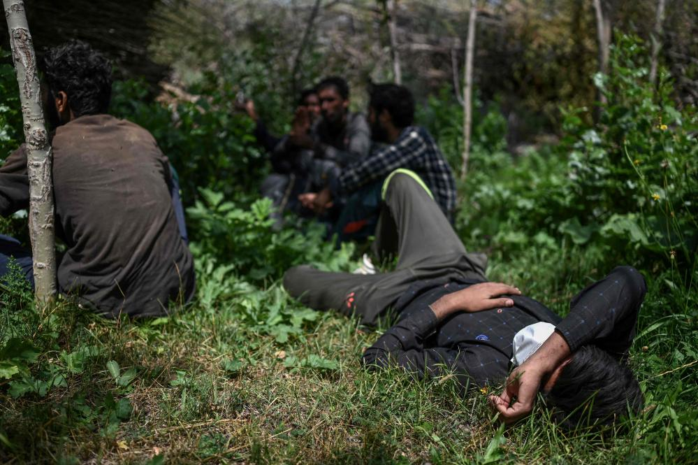 Afghan migrants waiting for smugglers in Tatvan, eastern Turkey