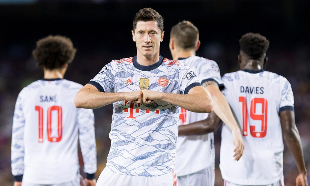 Robert Lewandowski celebrates scoring the first of his two goals. The forward has scored in 18 successive appearances for Bayern Munich.