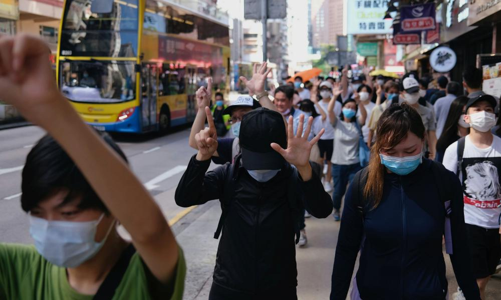 """Pro-democracy protesters raise their hands up as a symbol of the """"Five demands, not one less"""" during a march against the looming national security legislation in Hong Kong, China June 28, 2020. Credit: REUTERS/Tyrone Siu"""