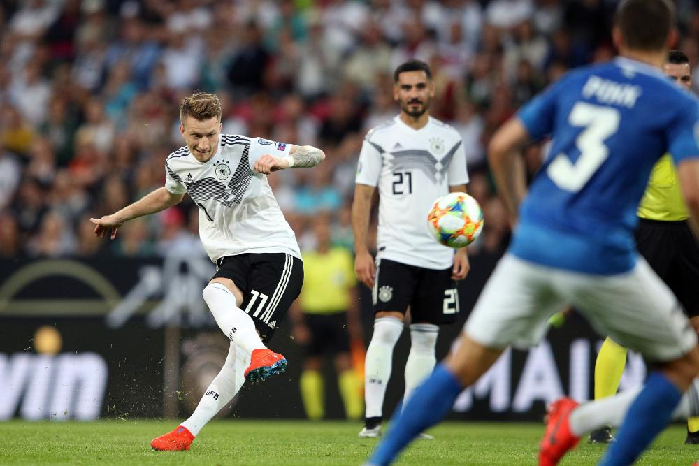Marco Reus fires in a free-kick for Germany's fifth, and his second goal of the night.