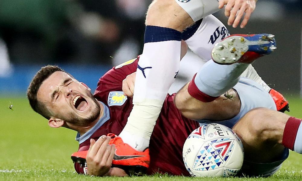 West Bromwich Albion's Chris Brunt steps on the arm of Aston Villa's John McGinn.