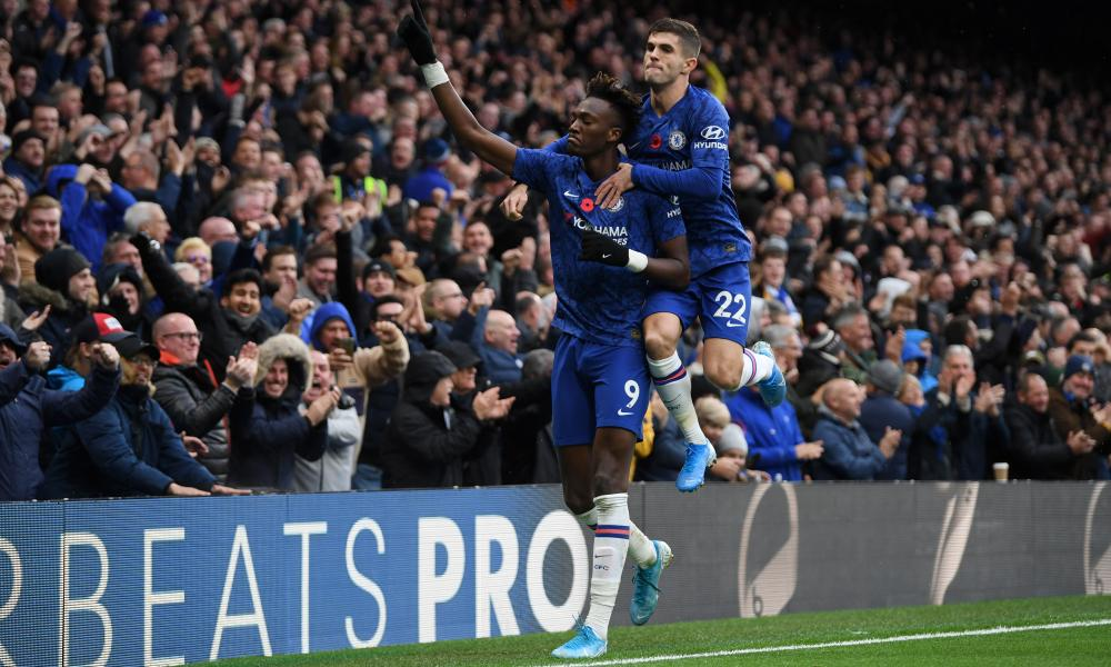 Tammy Abraham of Chelsea celebrates with Christian Pulisic of Chelsea after scoring his team's first goal.