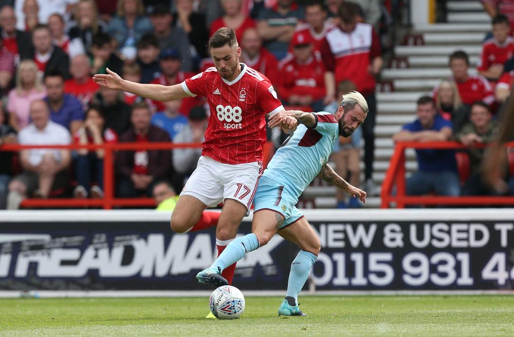 Ben Brereton battles with Steven Defour during a pre-season friendly against Burnley.