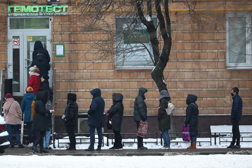 People queue outside a medical centre in Moscow