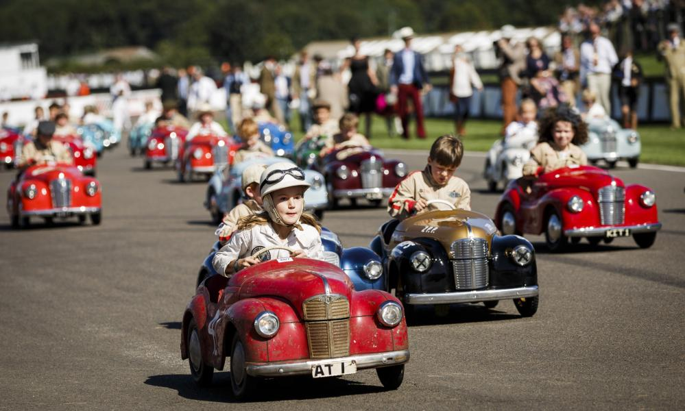 Top gear: children take part in a vintage pedal car race during the Goodwood Revival.