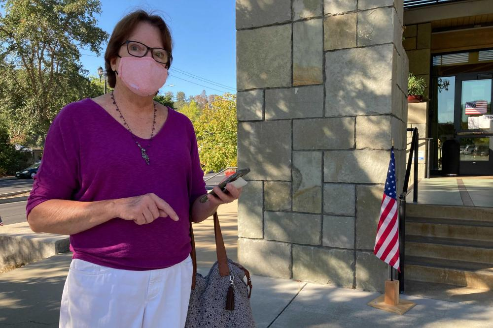 Janet Webb, 69, stands outside the Veterans Memorial building in Lafayette, California, after voting to recall Gavin Newsom on Tuesday.