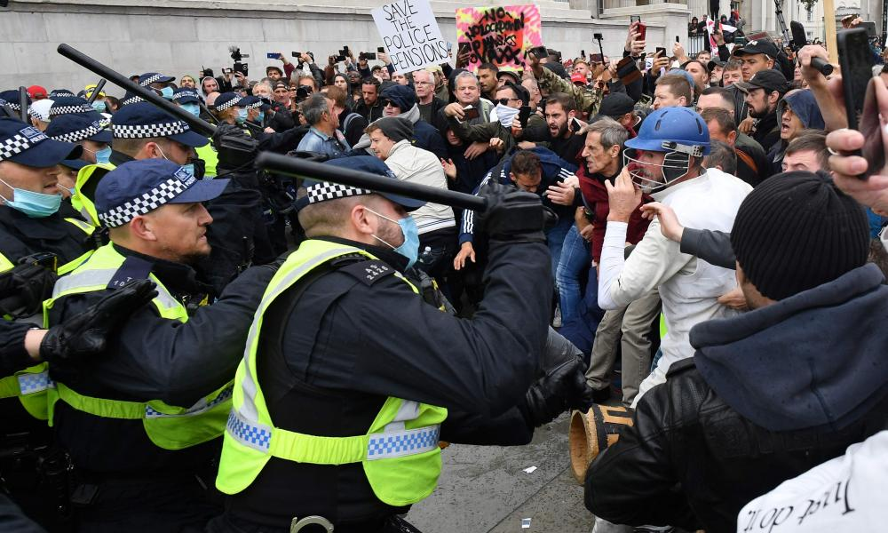 Police move in to disperse protesters in Trafalgar Square in London on September 26, 2020, at a 'We Do Not Consent!' mass rally against vaccination and government restrictions .