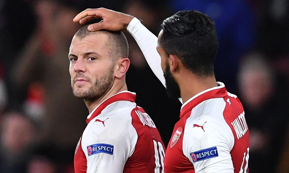 Arsenal's Jack Wilshere, left is congratulated by fellow goalscorer Theo Walcott.