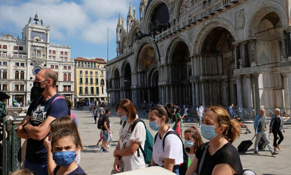 Tourists queue to enter the St Mark's Tower in Venice, Italy.