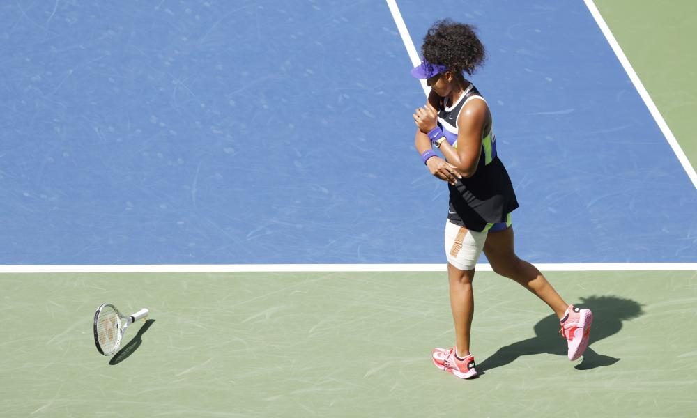 Naomi Osaka throws her racket during her match against Marta Kostyuk.