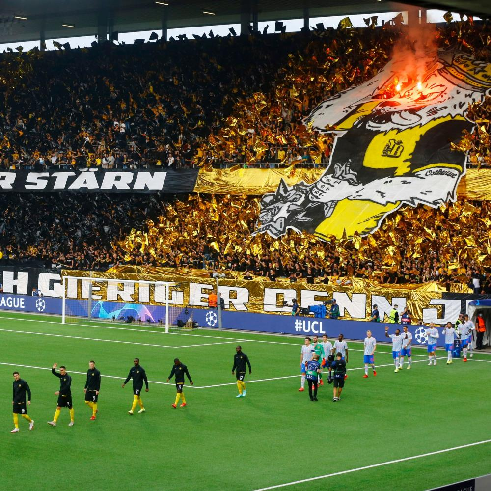 Young Boys and Manchester United players walk out before the match.