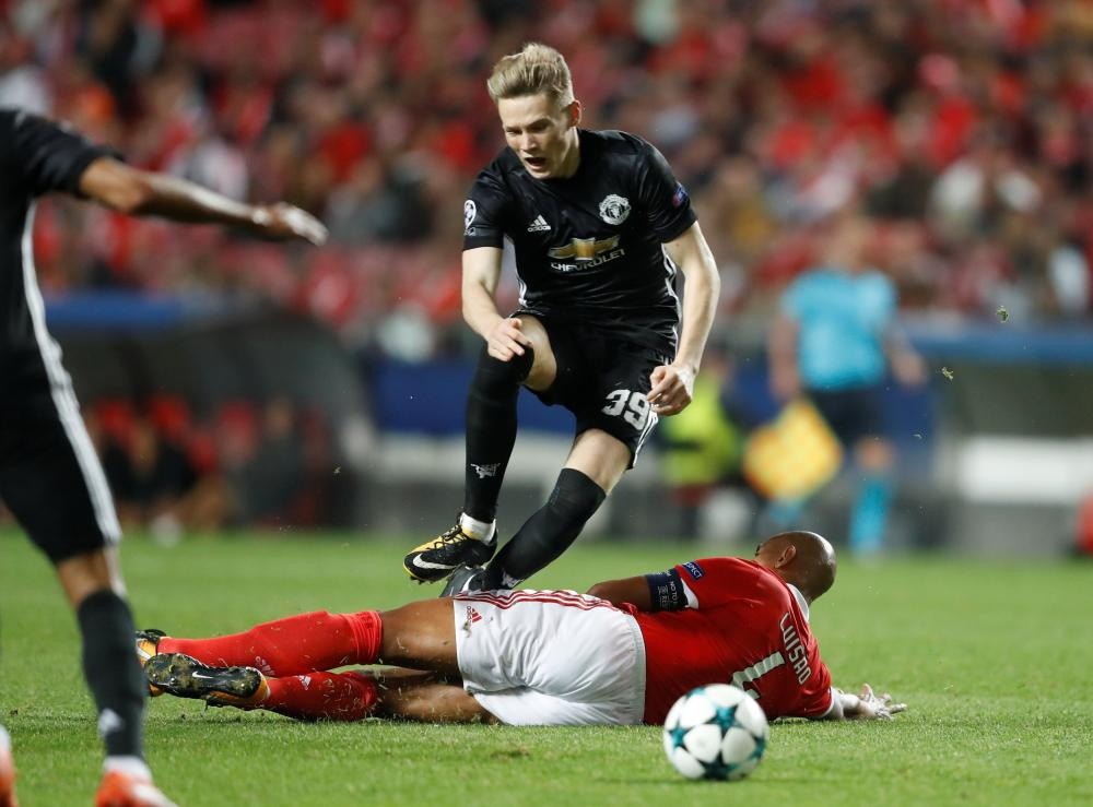 Luisao fouls McTominay leading to a second yellow and red.