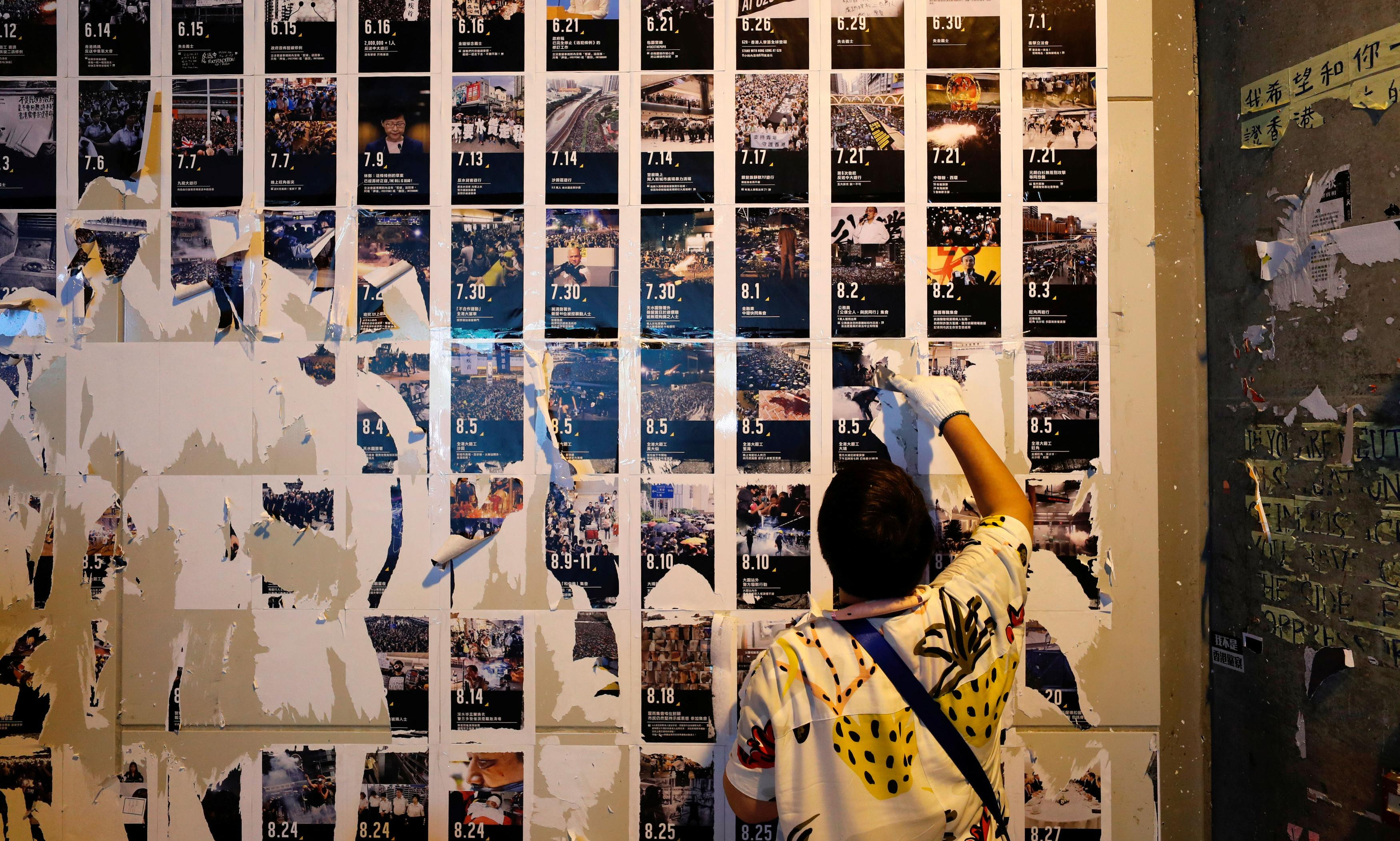 Pro-China supporters tear down Hong Kong's 'Lennon Walls'