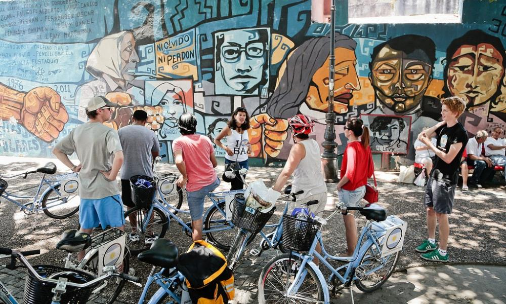 Stopping at a mural in the La Boca neighbourhood on a cycling tour of Buenos Aires.