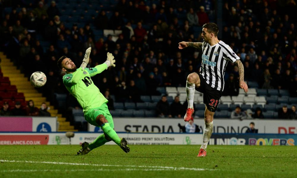 Newcastle's Joselu prods the ball past Blackburn Rovers goalkeeper David Raya for the Magpies' third goal.