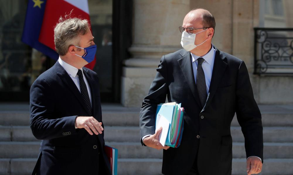 The French prime minister Jean Castex and junior minister for tourism and francophonie Jean-Baptiste Lemoyne, wearing face masks as they leave the last weekly cabinet meeting before summer vacation break, at the Elysee Palace in Paris.