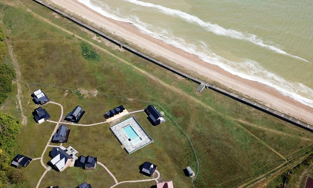 View from the air of cabins by the sea