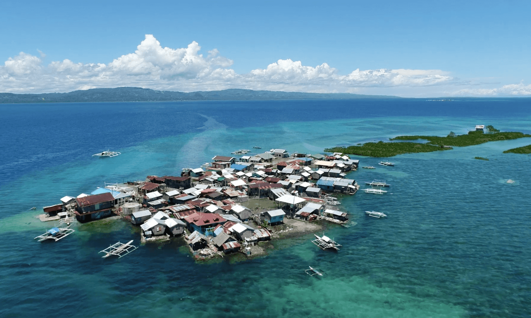 Enduring the tide: the flooded Philippine islands that locals won't leave