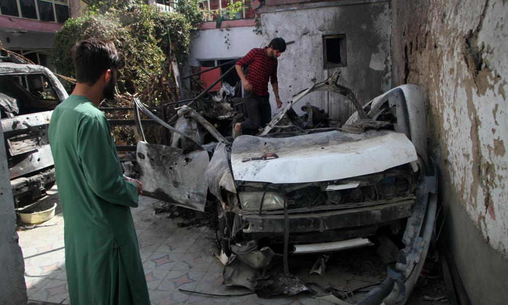 Damaged vehicles are seen on 2 September at the site of a deadly US airstrike in Kabul, capital of Afghanistan.